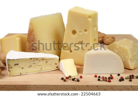 Variety of cheese: camembert, gouda, brie with nuts, parmesan, goat, sheep and other hard cheeses - stock photo