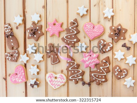 Variety of christmas cookies on rustic wooden background - stock photo