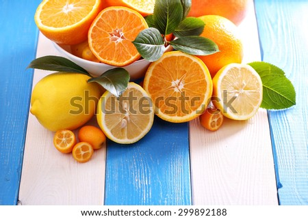 Variety of citrus fruits on colorful background - stock photo
