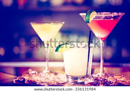 Variety of cocktails at the bar. - stock photo