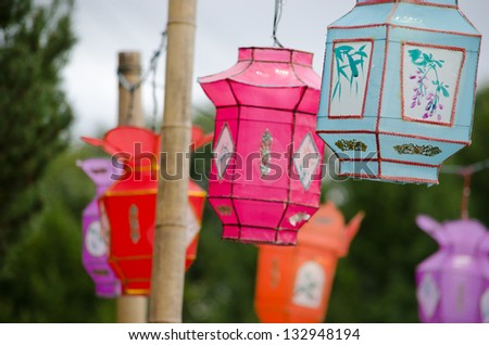Variety of colorful Chinese Paper Lanterns in Montreal Botanic Garden - stock photo