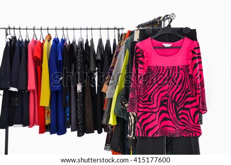 Variety of colorful female clothing on hanging - stock photo
