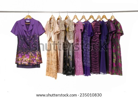 Variety of colorful female evening dress clothing on hanging  - stock photo