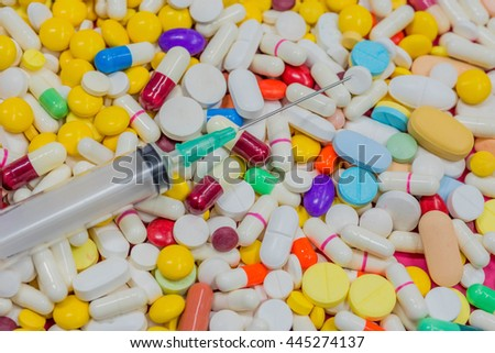 Variety of colorful medication and on syring. Top View, Closeup. Use for background.