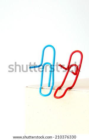 variety of colorful paper clips on white background : family talk together concept - stock photo