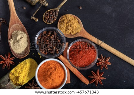 Variety of colorful spices, black background