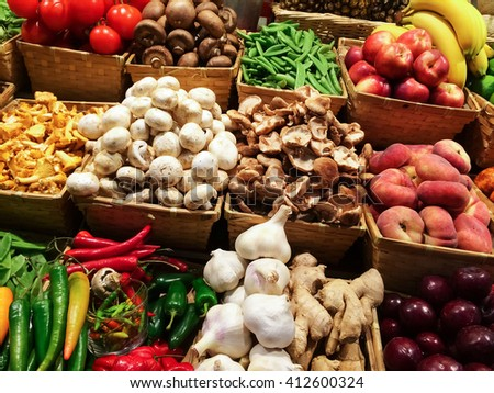 Variety of colorful vegetables and fruits at the market.