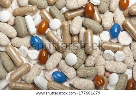 variety of colorfull pills and tablets on white background