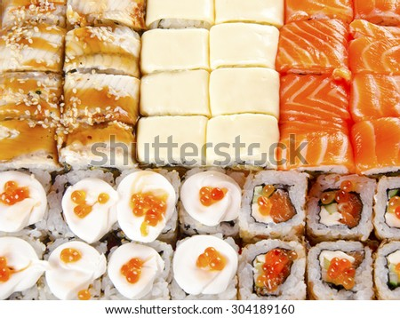 Variety of different types of sushi rolls - stock photo