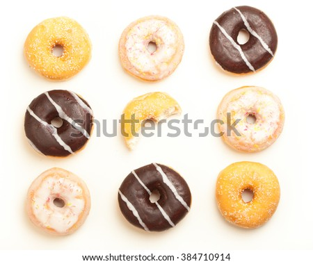 Variety of donuts, high angle view from above in three by three pattern.