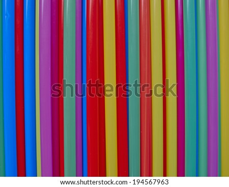 variety of drinking straws, colorful pattern background