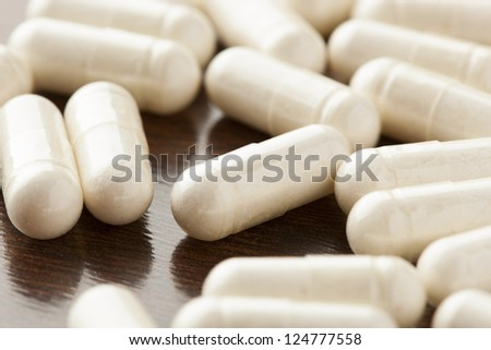 Variety of Drugs, Pills, Supplements, and Medication on a background - stock photo