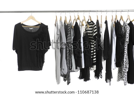 Variety of fashion clothing hanging on hangers - stock photo