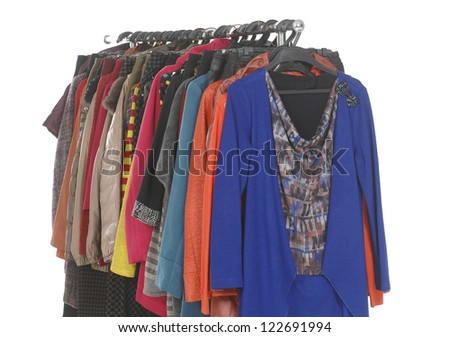 variety of female coat clothes hanging