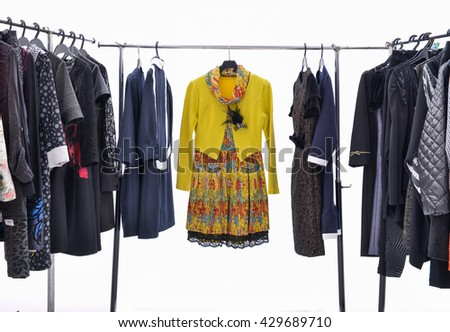 Variety of female different c clothing on hangers   - stock photo