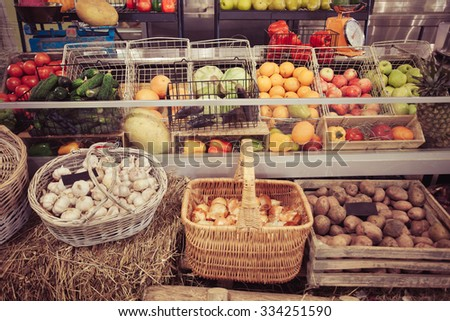 Variety of fresh fruits and vegetables in boxes - stock photo