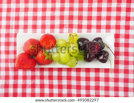 Variety of fresh fruits in top view.