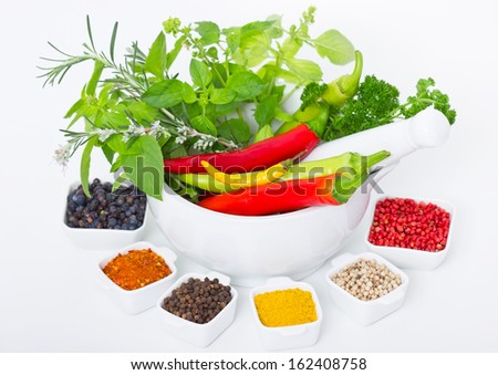 Variety of fresh herbs and spices - stock photo