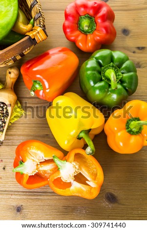 Variety of fresh organic peppers on the table. - stock photo