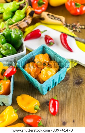 Variety of fresh organic peppers on the table.