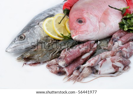 Variety of Fresh Sea Food. Mackerel, Red Snapper, Shrimp and Squid. - stock photo