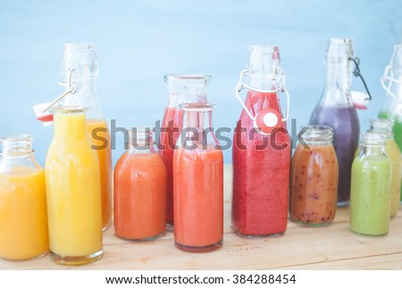 Variety of fresh smoothies in rainbow colors