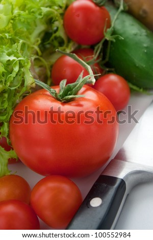 Variety of fresh vegetables. Vegetables background with kitchen knife - stock photo