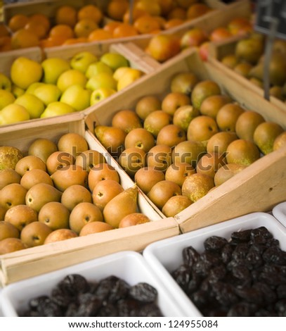 Variety of fruits arranged in boxes on farmers market