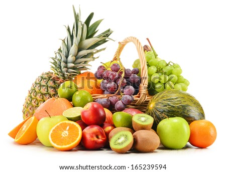 Variety of fruits in wicker basket isolated on white background - stock photo