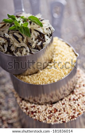 Variety of grains in stacked measuring cups - selective focus - stock photo