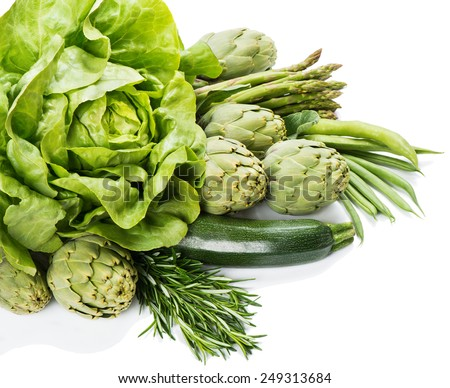Variety of green vegetables isolated on white background. - stock photo