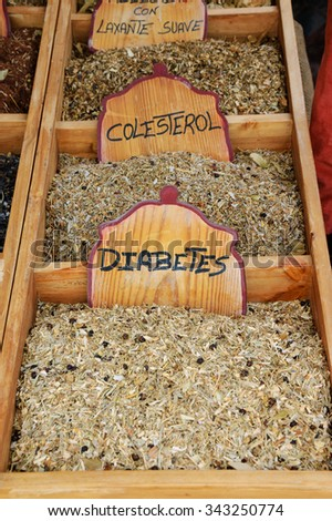 Variety of healing herbal teas at counter in street market in Portugal. - stock photo