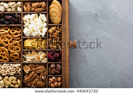 Variety of healthy snacks overhead shot in a wooden box