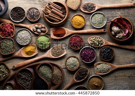 variety of herbs and spices on rustic wooden background, top view.Creative and national cuisine and cooking concept.