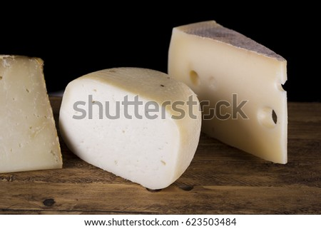 variety of Italian cheese on wooden cutting board