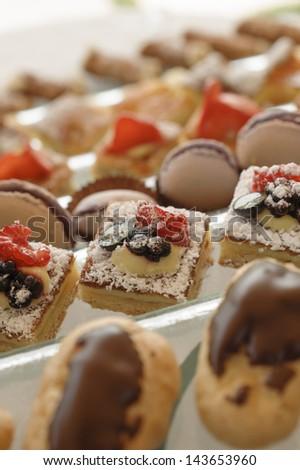 Variety of italian pastry on tray display - stock photo