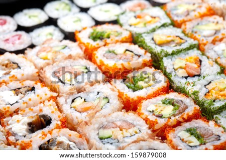 Variety of japanese sushi rolls. - stock photo