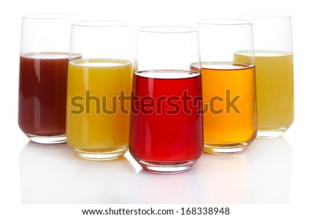 Variety of juices in glasses, isolated on white - stock photo