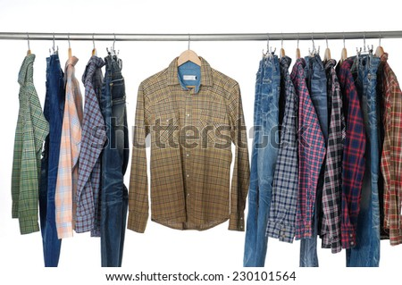 Variety of Men's different sleeved plaid cotton on hanger - stock photo
