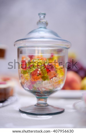 variety of mixed colorful gummy jelly bears in  a bowl - stock photo