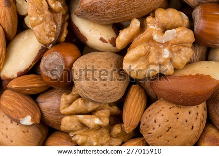 Variety of Mixed Nuts as a background - close up image - stock photo