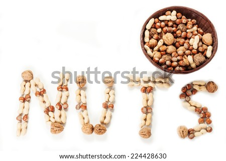 variety of nuts forming an inscription - stock photo