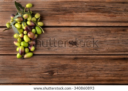 Variety of olives on old wood planks