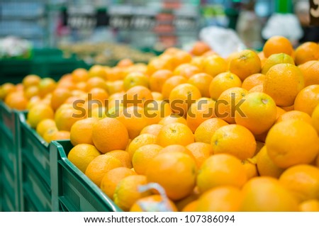 Variety of oranges on boxes in supermarket - stock photo
