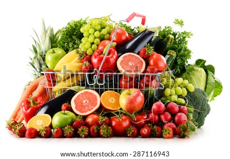 Variety of organic vegetables and fruits in shopping basket isolated on white
