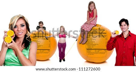 Variety of people standing around oranges with a nutrition labels - stock photo