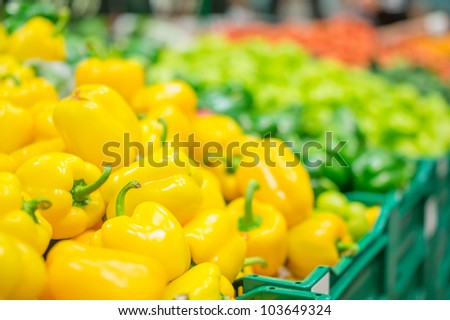 Variety of peppers in boxes in supermarket