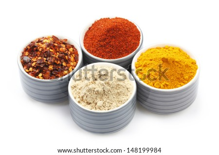 Variety of raw Authentic Indian Spice Powder on bowl isolated in white background.  - stock photo