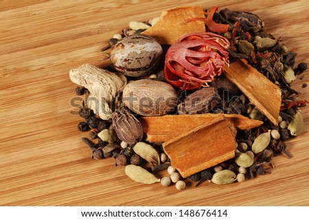Variety of raw Authentic Indian Spices on wooden background.  - stock photo