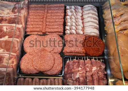 Variety Of Raw Meat - Kebabs Of Minced Meat, Beef Patties, Pork Skewers,Kebabs Wrapped In Bacon, Sausages At The Market Place - stock photo
